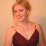 Isabel Mendenhall, Minx's perfect voice.